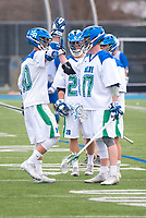 Members of the Salve Regina Men's Lacrosse Team encourage each other before the start of the Roger Williams game at Gaudet Field in Middletown.