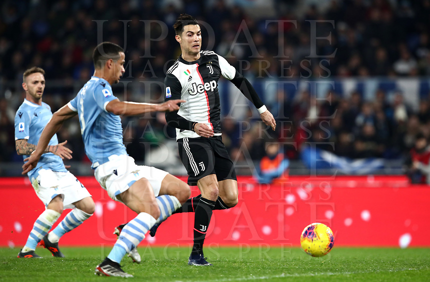 Football, Serie A: S.S. Lazio - Juventus Olympic stadium, Rome, December 7, 2019. <br /> Juventus' Cristiano Ronaldo (r) is going to score in spite of Lazio's Luis Felipe (l) during the Italian Serie A football match between S.S. Lazio and Juventus at Rome's Olympic stadium, Rome on December 7, 2019.<br /> UPDATE IMAGES PRESS/Isabella Bonotto