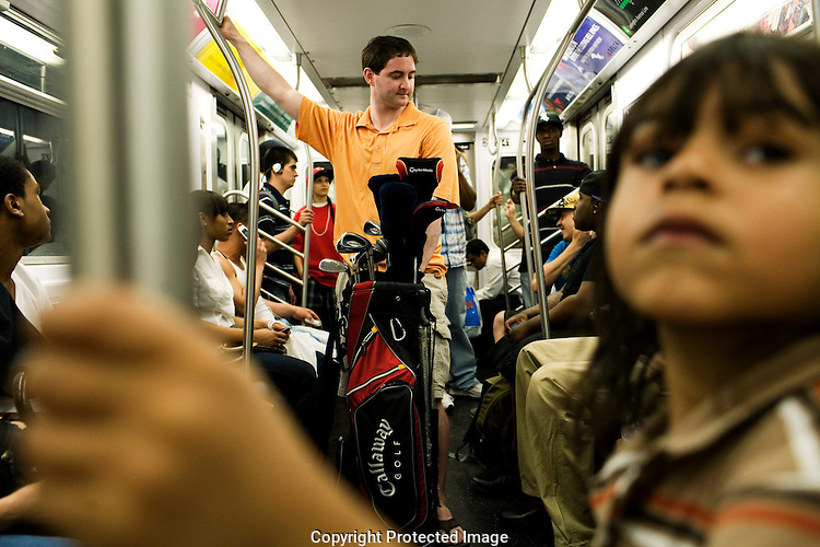 NEW YORK - MAY 22: Ryan Knopp rides the 4 train to play golf at Mosholu golf course in the Bronx,  on Friday, May 22, 2009. (Photo by Landon Nordeman