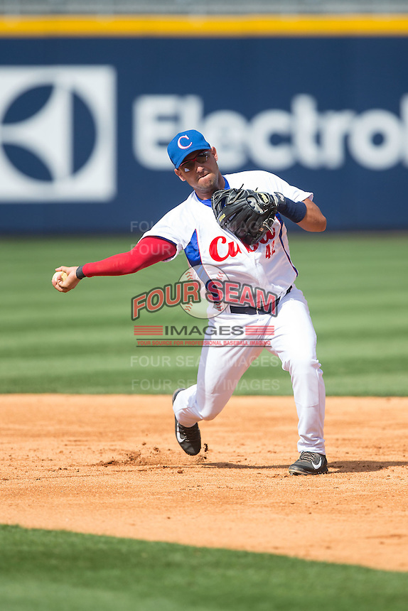 Yordan Manduley Escalona (42) of the Cuban National Team takes infield practice prior to the game against the US Collegiate National Team at BB&T BallPark on July 4, 2015 in Charlotte, North Carolina.  The United State Collegiate National Team defeated the Cuban National Team 11-1.  (Brian Westerholt/Four Seam Images)
