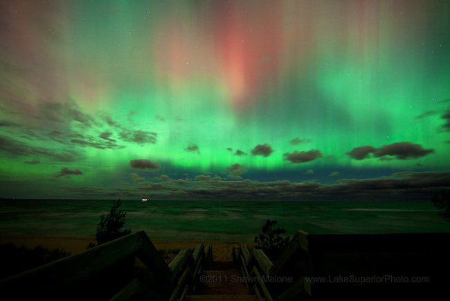 Incredibly bright aurora borealis northern lights multi colored curtain over Lake Superior from the M-28 beach stairs, Marquette MI- featured on National Geographic Daily News 10/24/2011