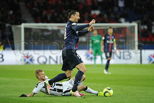 29.04.2016. Paris, France. French league 1 football. Paris St German versus Rennes.  ZLATAN IBRAHIMOVIC (psg) skips the tackle from PEDRO HENRIQUE (ren)
