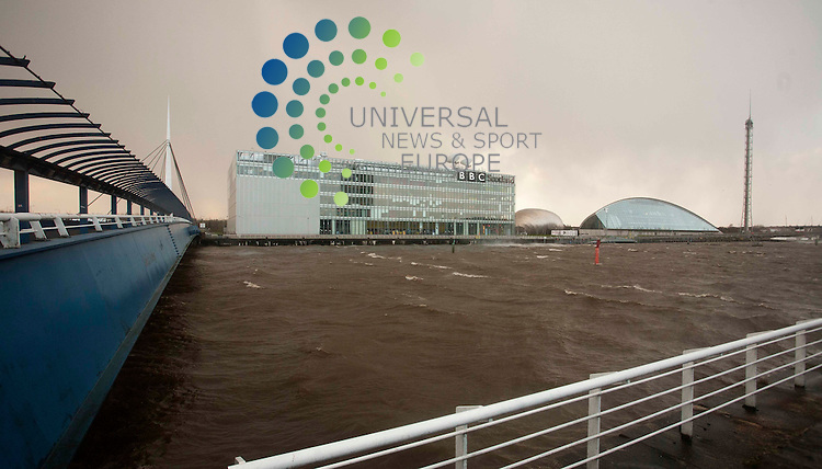 The River Clyde's level rises dangerously high outside the BBC HQ in Glasgow.  Picture: Johnny Mclauchlan Universal News and Sport (Europe) 08/12/2011