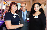 SOUTHINGTON,  CT-092519JS08- Alisa Hunt, left, and Stephanie Caban, both of Post University, with Selim Noujaim at the 25th Annual Malcolm Baldrige Chamber Awards gala held at the Aquaturf in Southington. The event was hosted by the Waterbury Regional Chamber. <br /> Jim Shannon Republican-American