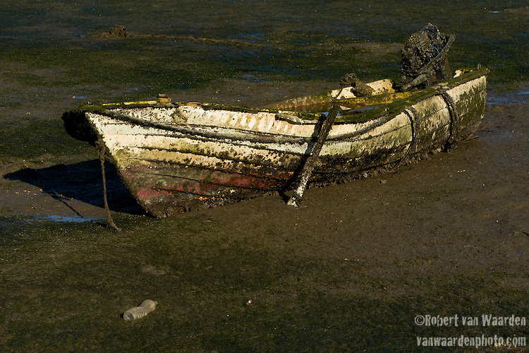 Boats stuck in teh mud in Faro, Portugal