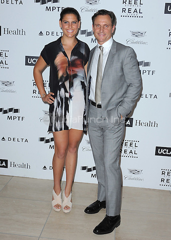 LOS ANGELES, CA - APRIL 25:  Tony Goldwyn and Anna Musky Goldwyn at the 4th Annual Reel Stories, Real Lives Benefit at Milk Studios on April 25, 2015 in Los Angeles, California. Credit: mpiPGSK/MediaPunch