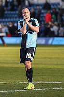 Goalscorer Michael Harriman of Wycombe Wanderers applauds the home fans after the Sky Bet League 2 match between Wycombe Wanderers and Mansfield Town at Adams Park, High Wycombe, England on 25 March 2016. Photo by David Horn.