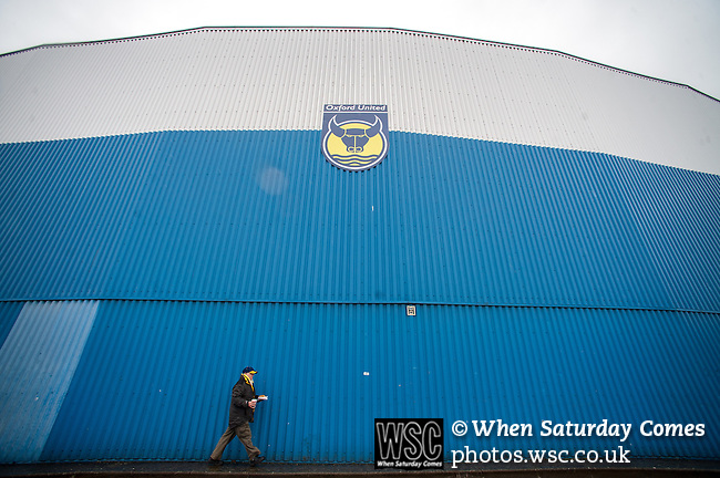 Oxford United 1 Accrington Stanley 2, 20/02/2016. Kassam Stadium, League Two. Oxford's home ground is the Kassam Stadium in Oxford and has a capacity of 12,500. United moved to the stadium in 2001 after leaving the Manor Ground, their home for 76 years. An Oxford supporter heads to the game with a tea and a burger. Photo by Simon Gill.