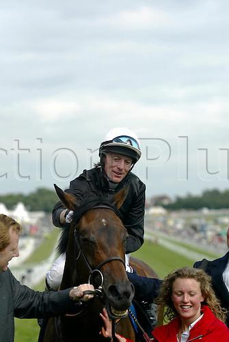 4 June, 2004: Portrait of Jockey KIEREN FALLON after winning The Vodafone OAkS on OUIJA BOARD at Epsom Photo: Glyn Kirk/Action Plus...040604 horse racing rider jockeys flat