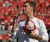 American Idol winner and Garner resident Scotty McCreary sings the National Anthem prior to the game.  It was also McCreary's 18th birthday. NC State defeated Central Michigan 38-24 on Saturday, October 8, 2011 at Carter-Finley Stadium in Raleigh. Photo by Al Drago.