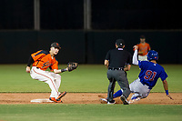AZL Giants shortstop Nico Giarratano (9) prepares to tag Jose Gutierrez as field umpire John Perez positions himself to make the call during Game Three of the Arizona League Championship Series against the AZL Cubs on September 7, 2017 at Scottsdale Stadium in Scottsdale, Arizona. AZL Cubs defeated the AZL Giants 13-3 to win the series two games to one. (Zachary Lucy/Four Seam Images)