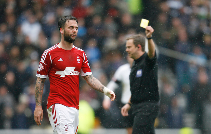 Nottingham Forest's Danny Fox (L) is shown a yellow card by the referee<br /> <br /> Photo by Jack Phillips/CameraSport<br /> <br /> Football - The Football League Sky Bet Championship - Derby County v Nottingham Forest - Saturday 22nd March 2014 - iPro Stadium - Derby<br /> <br /> &copy; CameraSport - 43 Linden Ave. Countesthorpe. Leicester. England. LE8 5PG - Tel: +44 (0) 116 277 4147 - admin@camerasport.com - www.camerasport.com