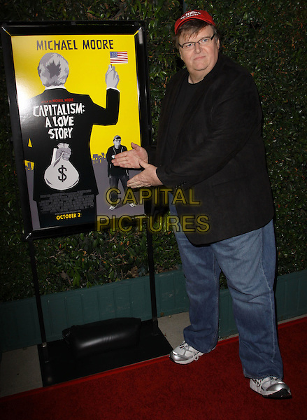 """MICHAEL MOORE .""""Capitalism: A Love Story"""" Los Angeles Premiere held At AMPAS Samuel Goldwyn Theater, Beverly Hills, California, USA..September 15th, 2009.full length black suit jacket denim jeans jacket silver trainers sneakers hat glasses hands.CAP/ADM/KB.©Kevan Brooks/AdMedia/Capital Pictures."""