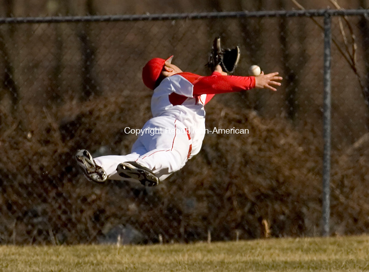 WOLCOTT, CT--09 APRIL 2007--040907JS04-Wolcott's Nick Negretti dives for a fly ball in center field during their game against Holy Cross Monday at the BAW complex in Wolcott.<br /> Jim Shannon / Republican-American