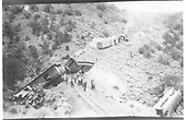 Elevated view of Chili Line #425 wrecked on Barranca Hill, 5 miles n. of Embudo.  A relief train with two boxcars is in the background.<br /> D&amp;RGW  Barranca Hill, NM  7/1929