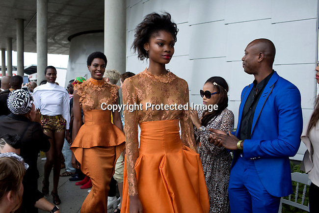 JOHANNESBURG, SOUTH AFRICA NOVEMBER 1: Sixteen year old Nigerian model Favour Lucky walks for the South African designer David Tlale while showing his latest collection at Mercedes Benz Africa fashion week Africa on November 1, 2014 held at Melrose Arch in Johannesburg, South Africa. Designers from all over Africa showed their best collections at the yearly event. David Tlale is the most known South African designer and he has shown back to back at New York fashion week. (Photo by: Per-Anders Pettersson)