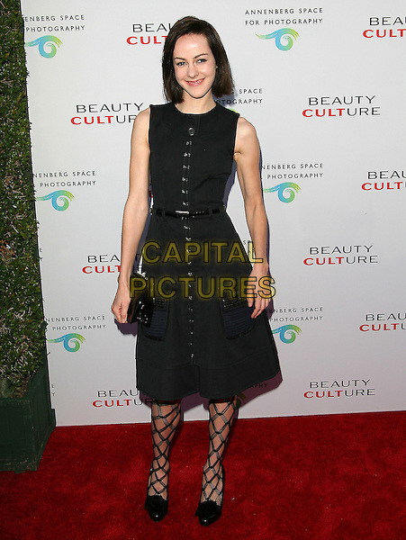 JENA MALONE .at The opening of Beauty Culture - a photographic exploration of how feminine beauty is defined, challenged and revered in modern society held at Annenberg Space for Photography in Century City, California, USA,  .May 19th 11..full length dress tights patterned  buttons shirt belt shoes  black sleeveless                                             .CAP/RKE/DVS.©DVS/RockinExposures/Capital Pictures.