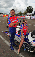 Mar. 9, 2012; Gainesville, FL, USA; NHRA pro stock motorcycle rider Hector Arana Jr (left) during qualifying for the Gatornationals at Auto Plus Raceway at Gainesville. Mandatory Credit: Mark J. Rebilas-