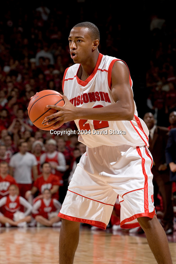MADISON, WI - NOVEMBER 30: Guard Michael Flowers #22 of the Wisconsin Badgers during the game against the Maryland Terrapins at the Kohl Center on November 30, 2004 in Madison, Wisconsin during the ACC-Big Ten Challenge. The Badgers beat the Terrapins 69-64. (Photo by David Stluka) *** Local Caption *** Michael Flowers