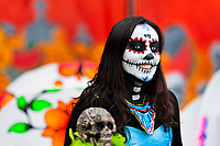 A young woman, dressed as La Catrina, a Mexican pop culture icon representing the Death, takes part in the Day of the Dead festival in Mexico City, Mexico, 28 October 2016. Day of the Dead (Día de Muertos), a syncretic religious holiday combining the death veneration rituals of the ancient Aztec culture with the Catholic practice, is celebrated throughout all Mexico. Based on the belief that the souls of the departed may come back to this world on that day, people gather at the gravesites in cemeteries praying, drinking and playing music, to joyfully remember friends or family members who have died and to support their souls on the spiritual journey.