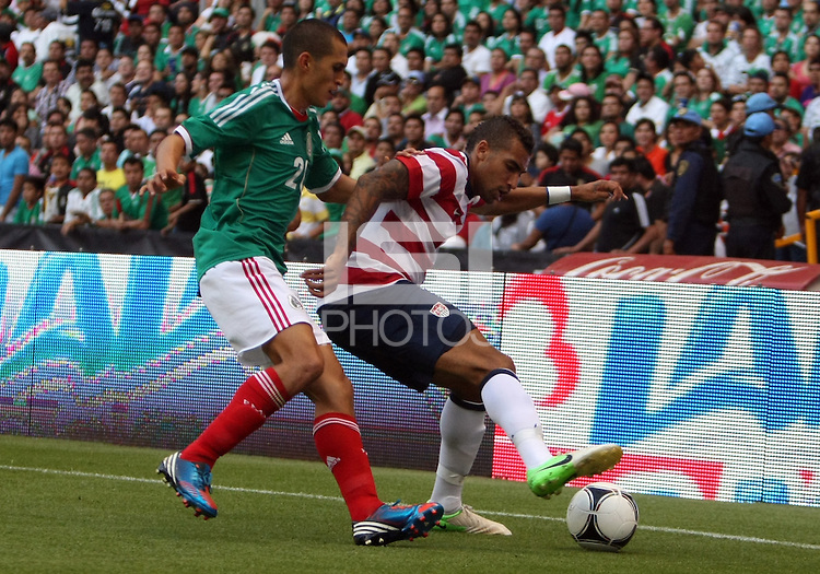 MEXICO CITY, MEXICO - AUGUST 15, 2012:  Danny Williams (6) of the USA MNT protects the ball from Jorge Torres Nilo (20) of  Mexico during an international friendly match at Azteca Stadium, in Mexico City, Mexico on August 15. USA won 1-0.
