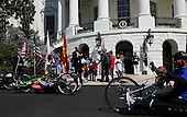 United States President Barack Obama, Vice President Joe Biden and Secretary of Veterans Affairs Robert McDonald watch the Wounded Warrior Ride at the White House, in Washington, DC, April 14, 2016.  The event helps raise awareness to the public about severely injured veterans and provides rehabilitation opportunities.<br /> Credit: Aude Guerrucci / Pool via CNP