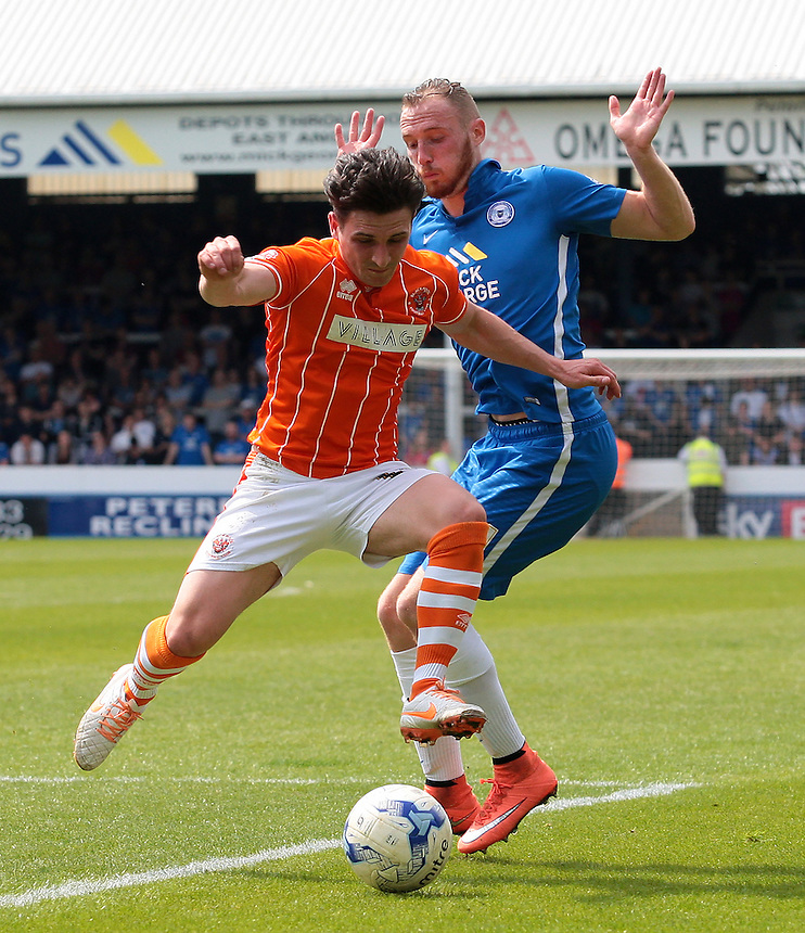 Blackpool's Jack Redshaw gets to the ball ahead of Peterborough United's Marcus Maddison<br /> <br /> Photographer David Shipman/CameraSport<br /> <br /> Football - The Football League Sky Bet League One - Peterborough United v Blackpool  - Sunday 8th May 2016 - ABAX Stadium - London Road   <br /> <br /> &copy; CameraSport - 43 Linden Ave. Countesthorpe. Leicester. England. LE8 5PG - Tel: +44 (0) 116 277 4147 - admin@camerasport.com - www.camerasport.com