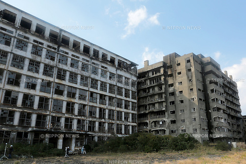 "In this December 11, 2013 photo, abandoned building stands as staff place measuring equipments to compile 3D data to utilize in director Shinji Higuchi's film, ""Attack on Titan"" on Hashima Island, commonly known as Gunkanjima, which means ""Battleship Island"" off Nagasaki, Nagasaki Prefecture, southern Japan. (Photo by Yuriko Nakao/AFLO) (No Third Party Sales, Minimum $50.00 Per Image)"
