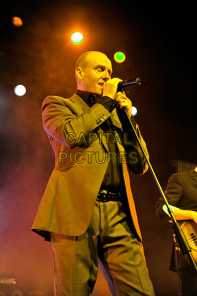 HEAVEN 17- Glenn Gregory.Heaven 17 performs on stage at HMV Forum, London, England. .November 28th, 2010.stage concert live gig performance music half length brown beige suit  singing.CAP/MAR.© Martin Harris/Capital Pictures.