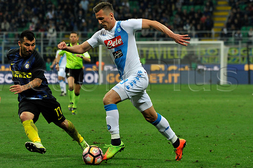 April 30th 2017, San Siro Stadium, Milan, Italy; Gary Medel of Inter competes for the ball with Arkadiusz Milik of Napoli  during the Serie A football match, Inter Milan versus Napoli; Napoli won the game by a score of 0-1