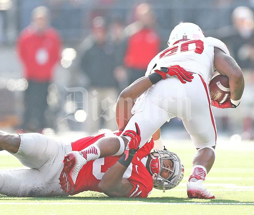 Ohio State Buckeyes linebacker Darron Lee (43) takes down Indiana Hoosiers quarterback Chris Covington (20) in second half action at Ohio Stadium on 22, 2014. (Chris Russell/Dispatch Photo)
