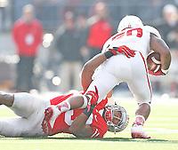 Ohio State Buckeyes linebacker Darron Lee (43) takes down Indiana Hoosiers quarterback Chris Covington (20) in second half action at Ohio Stadium on 22, 2014. (Chris Russell/Dispatch Photo)