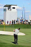 Marc Leishman (AUS) chips on to 14 during round 2 Four-Ball of the 2017 President's Cup, Liberty National Golf Club, Jersey City, New Jersey, USA. 9/29/2017.<br /> Picture: Golffile | Ken Murray<br /> <br /> All photo usage must carry mandatory copyright credit (&copy; Golffile | Ken Murray)