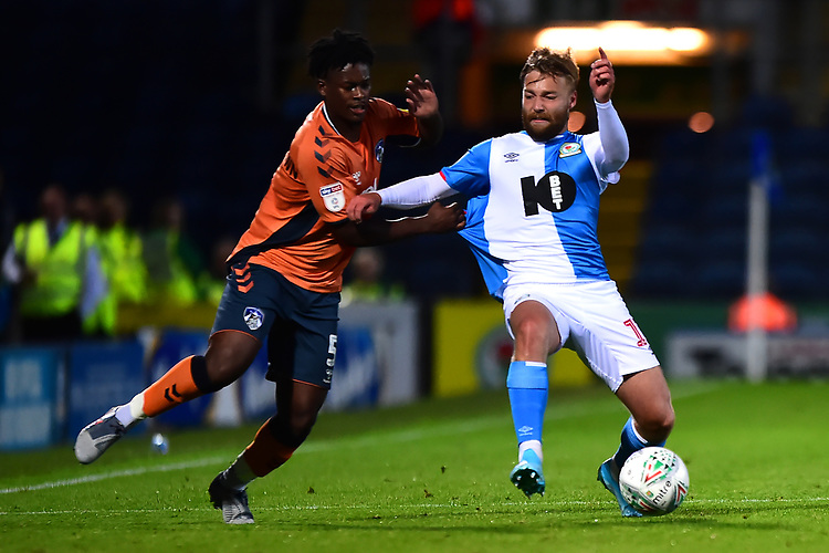 Blackburn Rovers' Harry Chapman vies for possession with Oldham Athletic's Ashley Smith-Brown<br /> <br /> Photographer Richard Martin-Roberts/CameraSport<br /> <br /> The Carabao Cup First Round - Tuesday 13th August 2019 - Blackburn Rovers v Oldham Athletic - Ewood Park - Blackburn<br />  <br /> World Copyright © 2019 CameraSport. All rights reserved. 43 Linden Ave. Countesthorpe. Leicester. England. LE8 5PG - Tel: +44 (0) 116 277 4147 - admin@camerasport.com - www.camerasport.com