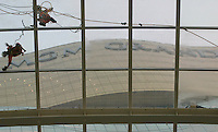 Workers clean a glass roof at the 'MGM Grand Macau' casino, Macau, China, 13 December 2007. When the casino opens its doors to the public next week (Tuesday 18 December 2007) it will be the latest casino to open in the ex-Portuguese enclave that has seen explosive growth in its gaming sector since it was liberalized in 2002. It will also mark the third American gaming operator to enter he increasingly crowded casino industry in Macau, (after the Las Vegas Sands Corporation and Wynn Resorts). The 'MGM Grand Macau' is a joint venture between MGM Mirage and Macau local partner Pansy Ho, daughter of Macau casino kingpin Stanley Ho, and the total project cost USD$1.25 billion to build.