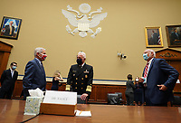 Dr. Anthony Fauci (L), director of the National Institute for Allergy and Infectious Diseases, Adm. Brett Giroir (C), Assistant Secretary of Health and Human Services for Health and Dr. Robert Redfield, director of the Centers for Disease Control and Prevention (CDC), talk before testifying to the House Subcommittee on the Coronavirus Crisis during a hearing on a national plan to contain the COVID-19 pandemic, on Capitol Hill in Washington, DC on Friday, July 31, 2020.  <br /> Credit: Kevin Dietsch / Pool via CNP /MediaPunch