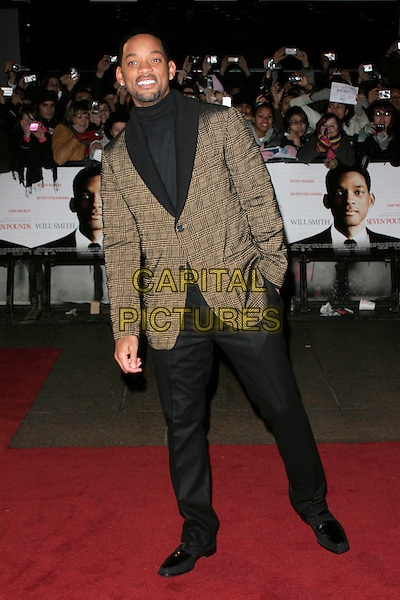 "WILL SMITH.The UK film premiere of ""Seven Pounds"" at the Empire Cinema, Leicester Square, London, England..January 14th 2009.full length black polo neck jumper top brown collar lapel plaid check checked jacket blazer trousers hand in pocket .CAP/AH.©Adam Houghton/Capital Pictures."