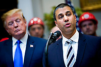 Ajit Pai, Chairman, Federal Communications Commission (FCC), right, delivers remarks on United States 5G deployment, addressing efforts to boots rural broadband internet access, in the Roosevelt Room at the White House in Washington, DC on April 12, 2019. Credit: Leigh Vogel / Pool via CNP/AdMedia