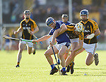 Podge Collins of Cratloe in action against Brandon O Connell and James Murphy of  Ballyea during the county senior hurling final at Cusack Park. Photograph by John Kelly.