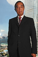 Ronald Arculli, Chairman of the Hong Kong Stock Exchange, poses in the Exchange's boardroom overloooking Hong Kong harbour