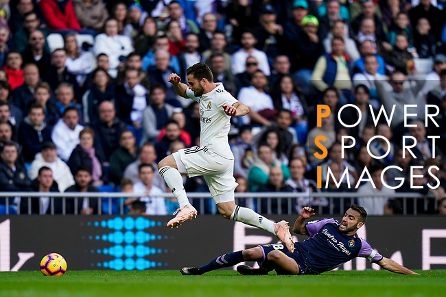 Nacho Fernandez of Real Madrid (L) jumps to avoid Antonio Jesus Regal Anguilo of Real Valladolid during the La Liga 2018-19 match between Real Madrid and Real Valladolid at Estadio Santiago Bernabeu on November 03 2018 in Madrid, Spain. Photo by Diego Souto / Power Sport Images
