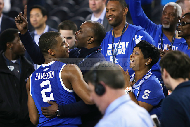 Aaron Harrison hugs his parents after defeating Wisconsin at the NCAA Final Four vs. Wisconsin at the AT&T in Arlington, Tx., on Saturday, April 5, 2014. Photo by Emily Wuetcher | Staff