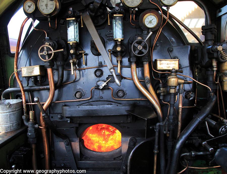 Heritage steam railway, Sheringham station, North Norfolk Railway, England, UK onboard steam engine with coal firebox