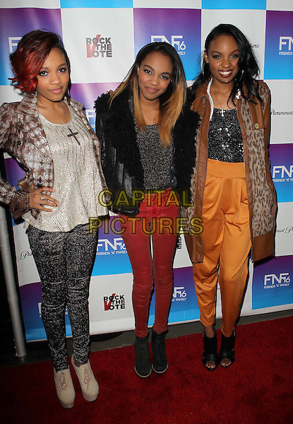 McClain Sisters.Paramount Studios' 16th Annual Friends 'N' Family Party Held At Paramount Studios, Los Angeles, California,.USA, 8th February 2013..full length group red jeans orange trousers black brown jacket grey gray top  shearling .CAP/ADM/KB.©Kevan Brooks/AdMedia/Capital Pictures.