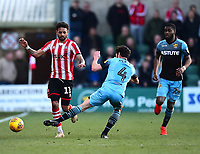 Lincoln City's Bruno Andrade is tackled by Stevenage's Michael Timlin<br /> <br /> Photographer Andrew Vaughan/CameraSport<br /> <br /> The EFL Sky Bet League Two - Lincoln City v Stevenage - Saturday 16th February 2019 - Sincil Bank - Lincoln<br /> <br /> World Copyright © 2019 CameraSport. All rights reserved. 43 Linden Ave. Countesthorpe. Leicester. England. LE8 5PG - Tel: +44 (0) 116 277 4147 - admin@camerasport.com - www.camerasport.com