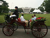 Washington, D.C. - June 19, 2007 -- A horse drawn carriage carries its passengers as entertainment during the Congressional Picnic on the South Lawn of The White House in Washington DC, Tuesday, June 19, 2007. <br /> Credit: Chris Kleponis - Pool via CNP