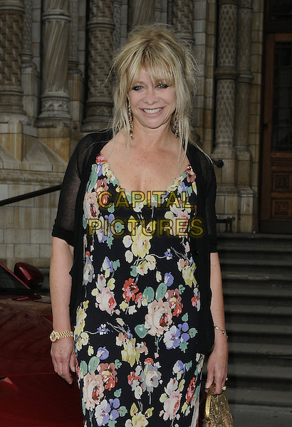 Jo Wood.The India Rocks fundraiser party, Natural History Museum, London, England..June 27th, 2011.half length black dress floral print yellow pink blue sheer .CAP/CAN.©Can Nguyen/Capital Pictures.