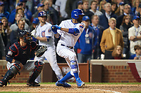 Chicago Cubs Dexter Fowler (24) hits a single in front of catcher Yan Gomes in the eighth inning during Game 3 of the Major League Baseball World Series against the Cleveland Indians on October 28, 2016 at Wrigley Field in Chicago, Illinois.  (Mike Janes/Four Seam Images)