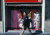 A man walks by the colorful Milk Fashion store front in the historic center of mexico city.
