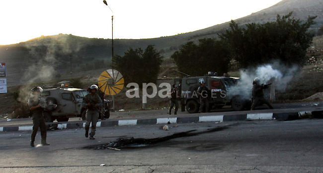 Israeli border policemen fire tear gas at Palestinian protesters during clashes in the West Bank city of Nablus, on November 20, 2012. The West Bank has witnessed almost daily demonstrations in support of Gaza Palestinians who have faced a week of Israeli air strikes against militants firing rockets at the Jewish state. Photo by Nedal Eshtayah